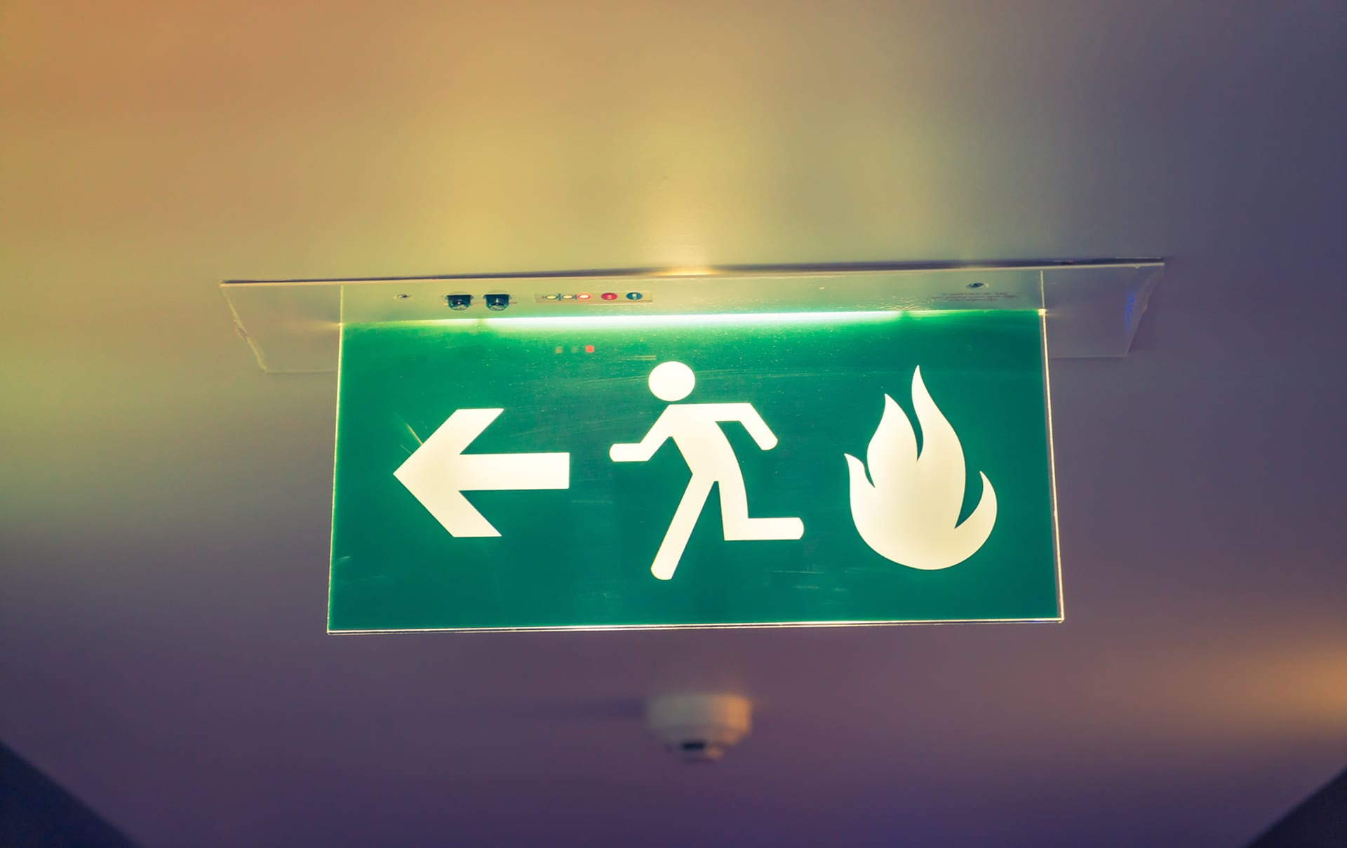 passive fire stopping exit sign on ceiling